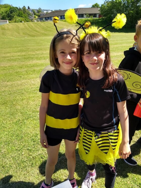 Two young pupils dressed as bees