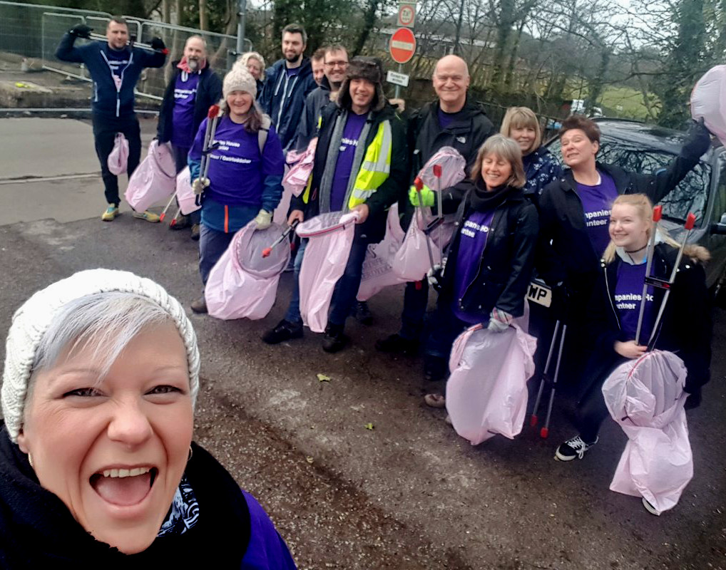 A selfie of the team holder litter pickers and pink bin bags.